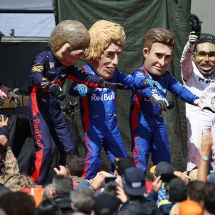 SPA, BELGIUM - AUGUST 25:  Performers dressed as Romain Grosjean of France and Haas F1, Max Verstappen of Netherlands and Red Bull Racing, Brendon Hartley of New Zealand and Scuderia Toro Rosso, Pierre Gasly of France and Scuderia Toro Rosso and Lewis Hamilton of Great Britain and Mercedes GP entertain the crowds during qualifying for the Formula One Grand Prix of Belgium at Circuit de Spa-Francorchamps on August 25, 2018 in Spa, Belgium.  (Photo by Charles Coates/Getty Images) // Getty Images / Red Bull Content Pool  // AP-1WPURQKDW2511 // Usage for editorial use only // Please go to www.redbullcontentpool.com for further information. //